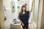 Editor and writer Annuska Angulo in the bathroom of Progreso and Prosperidad, Escandon, Mexico City