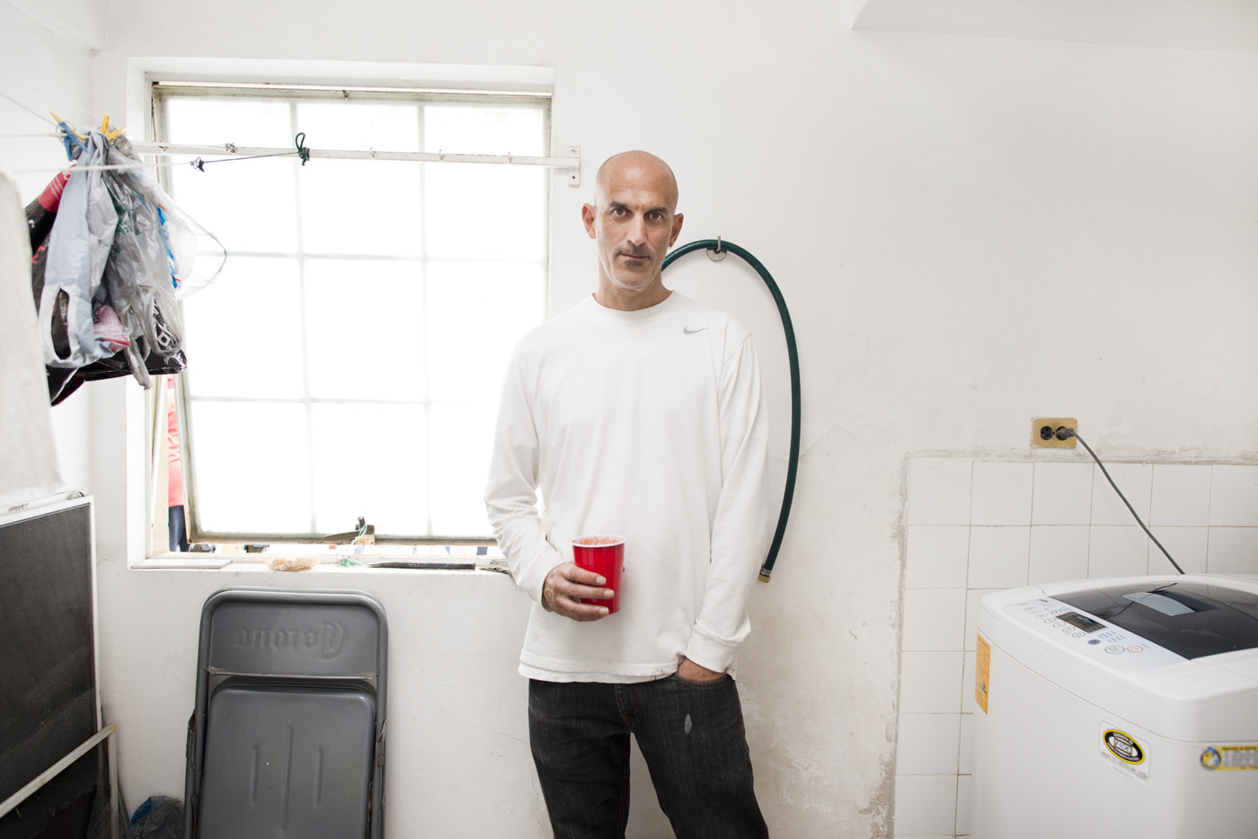 Writer/Photographer Kurt Hollander in his laundry room at his home in Condesa, Mexico City