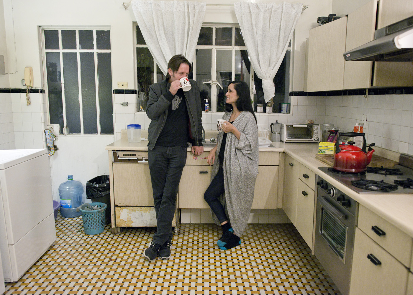 Photographer Yvonne Venegas and cinematographer Gregory Allen in their kitchen in la del Valle, Mexico City.