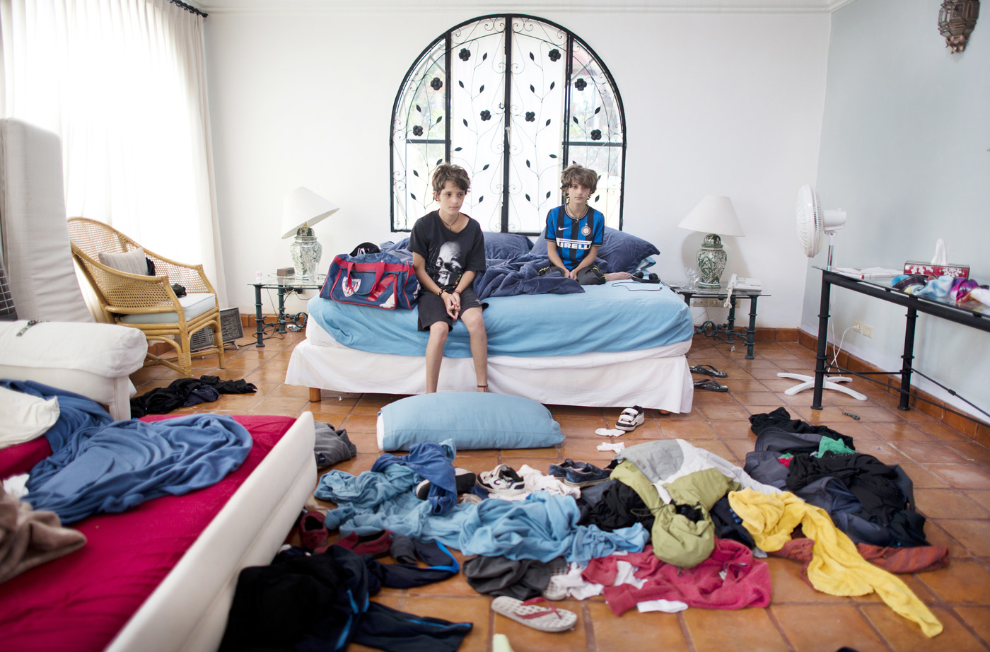 Maximo and Primo Hollander (twin brothers) in their room at a rental house in San Miguel de Allende, Mexico.