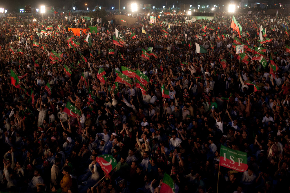 Supporters of the Pakistan Tehreek-e-Insaf, or the Movement for Justice, wave party flags at a rally in Lahore on March 23, 2013. Pakistani cricket legend-turned politician Imran Khan rallied around 100,000 flag-waving supporters in the eastern city of Lahore on Saturday ahead of a historic national election later this spring.