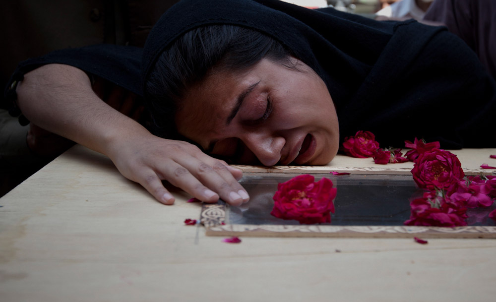 Ayesha Ishaque, younger sister of Mohammad Saud Ishaque, 26, who was killed in a plane crash in Islamabad, cries over his casket at the Pakistan Institute of Medical Sciences hospital in Islamabad on April 21, 2012. The Pakistani airliner with 127 people on board crashed in bad weather as it came in to land in Islamabad on April 20, scattering wreckage and leaving no sign of survivors. The Boeing 737, operated by local airline Bhoja Air, was flying to the capital from Pakistan's biggest city and business hub Karachi.