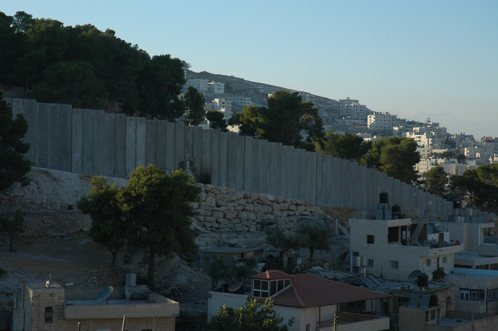 Al Ezariya, a Jerusalem suburb, is separated from Jerusalem by a 26 ft concrete wall. It snakes in and out separating houses, and families.