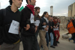 Israeli activists wearing {quote}I am Achmed Awad{quote} signs in 5 languages as a solidarity protest. Achmed Awad is a Budrus villager that was arrested for his particiaption in the protests. The intent to get arrested without any ID and recite, I am Achmed Awad to the Israeli army.