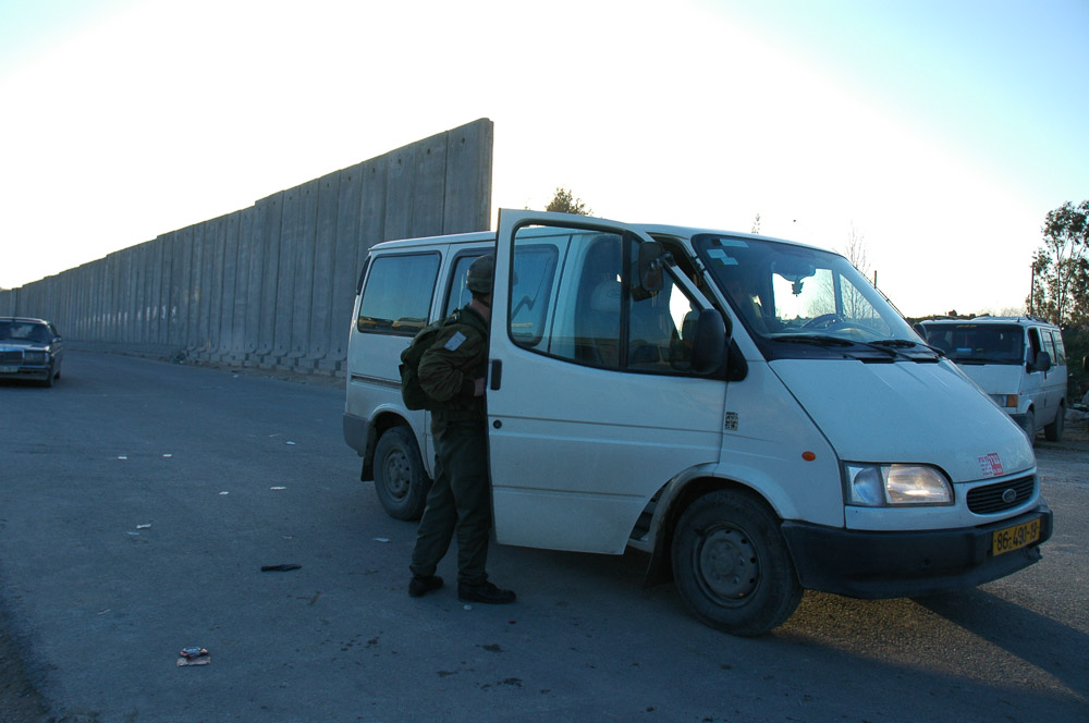 The 26ft high concrete wall at Qalandia separates Ramallah with A Ram.