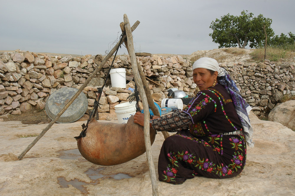Woman in Qawawis making yogurt