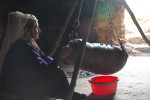 Woman in Qawawis making yogurt