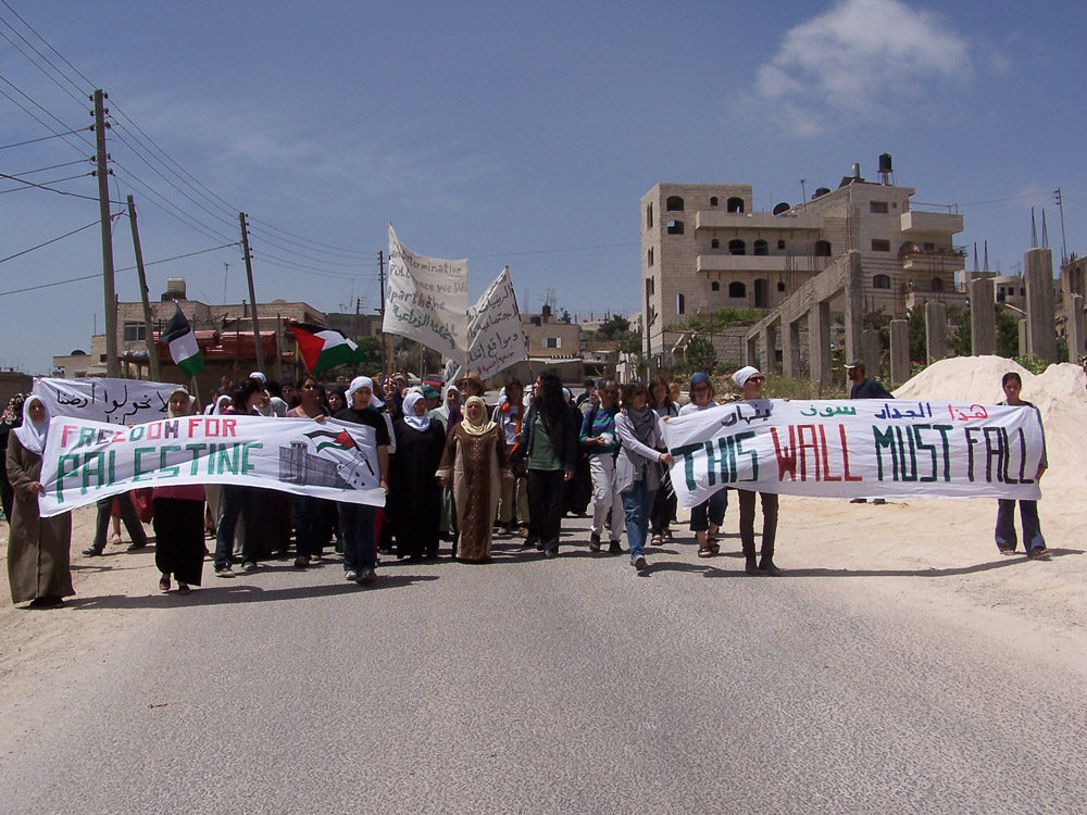 Palestinian, International, and Israeli women demonstrating against the construction of the wall.