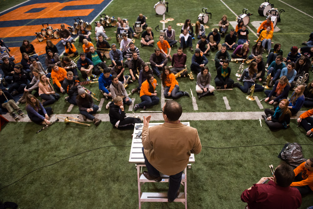 Syracuse University band director Justin Mertz gives final instructions during the last practice at the Carrier Dome on Wednesday leading up to Super Bowl weekend. Mertz coordinated with the Rutgers band director months before the two bands even started practicing.