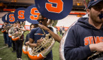 Morgan Christopher Edwards, a senior aerospace engineering major, performs in the tuba line during practice in the Carrier Dome the week before the Super Bowl. The band started practicing at the beginning of Spring semester in January.
