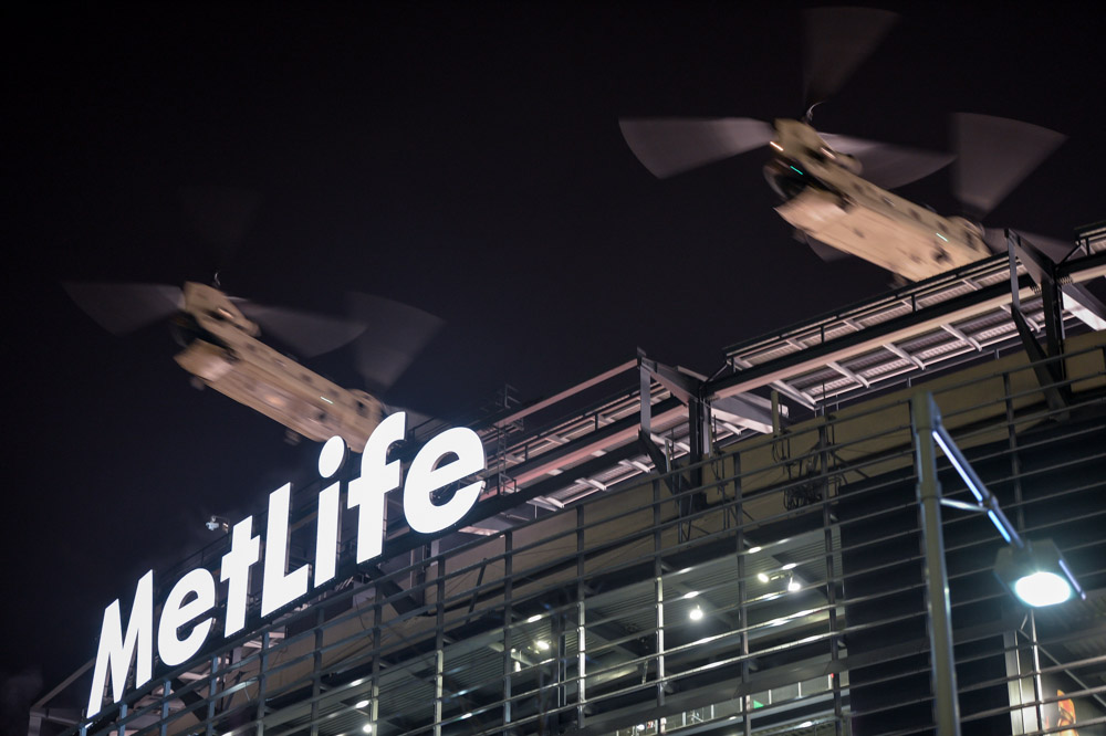 Two U.S. Army Chinook helicopters pass over MetLife Stadium as a part of the military flyover during the Super Bowl pregame show on Sunday evening.