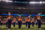 The Syracuse University Marching Band performs in front more than 80,000 people at MetLife Stadium as a part of the Super Bowl pregame show.
