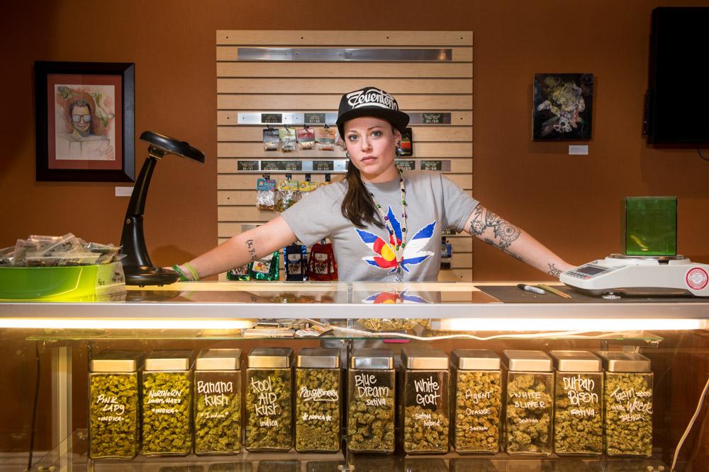 Andrea Sobel stands behind a display of an array of marijuana at the Terrapin Dispensary.