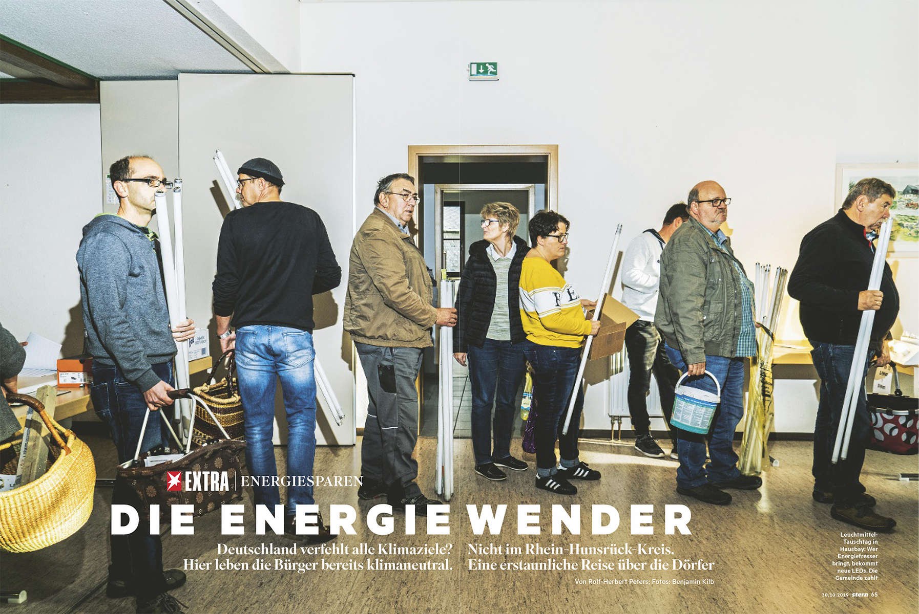 People of all various ages from the Germany village Hausbay in Rhineland-Palatinate are standing in line the village's community centre to exchange their old light bulbs with LED lights. The municipality sponsors the exchange to support energy change in Germany.