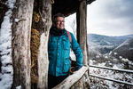 Germany's best known hiker Manuel Andrack is viewing the panorama from a hiking hut in the Vulkaneifel region in Germany
