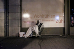 A homeless man is sitting on an old office chair on the streets of the Bahnhofsviertel district in Frankfurt