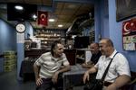 Men are sitting inside a Turkish café in the Bahnhofsviertel district in Frankfurt