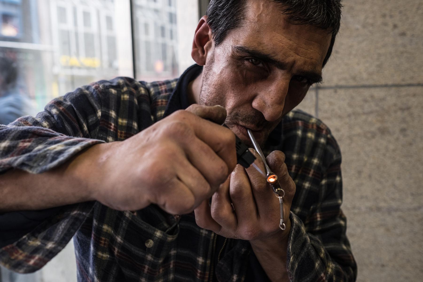 a crack addict smoking crack at the Bahnhofsviertel in Frankfurt