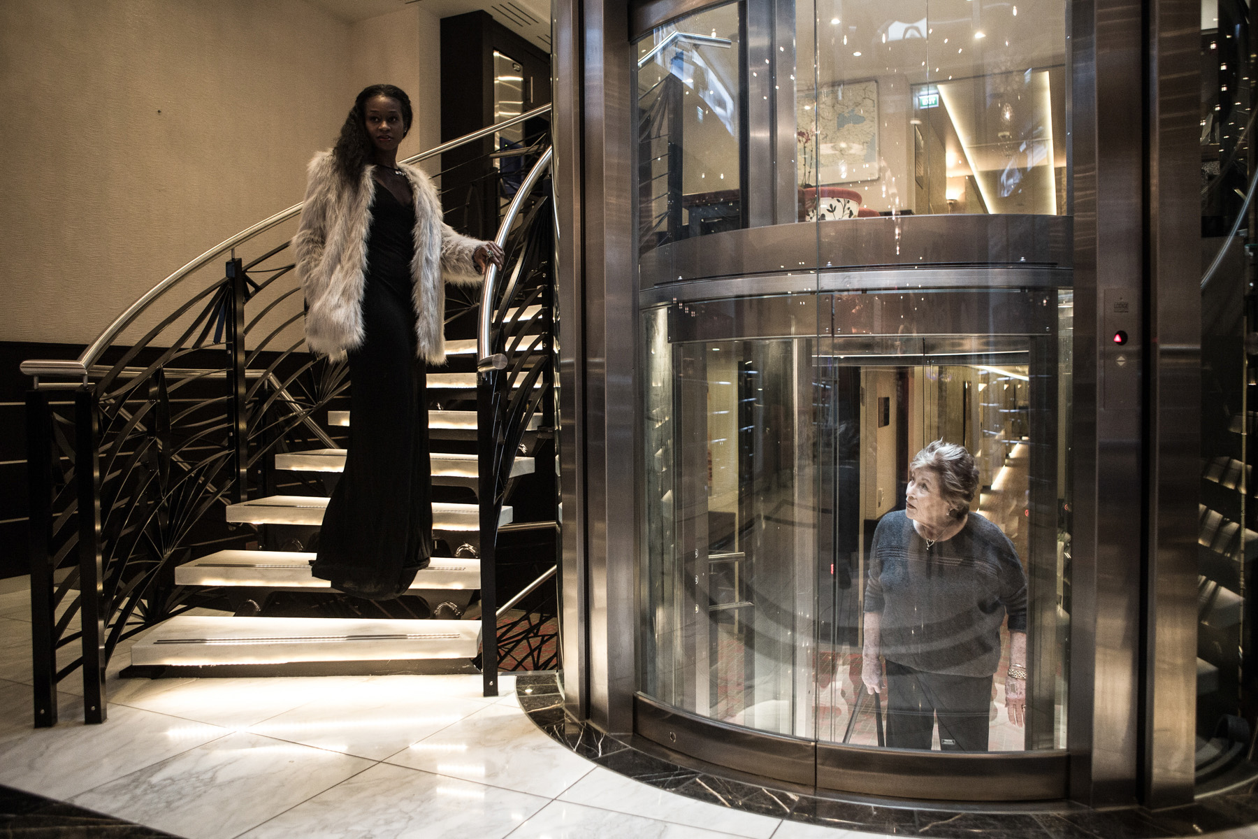 A passenger of the Danube cruise is watching from inside an elevator while another one walks up the stairs inside the cruise ship. For two weeks mainly North American tourists were traveling up the Danube to visit sites of Jewish heritage in Europe.