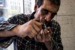 A man smokes a crack pipe in the 'Bahnhofsviertel' district in Frankfurt in Germany. This photo is part of a photo reportage about the 'Bahnhofsviertel', one of Europe's drugs hotspots.