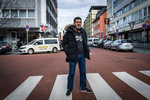 Cetin Gültekin is standing on a street close to a bar in the city of Hanau where his brother Gökhan und eight others were one year earlier by a right wing extremist.