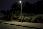 a jewish man praying next to a light post in Tel Aviv/Israel