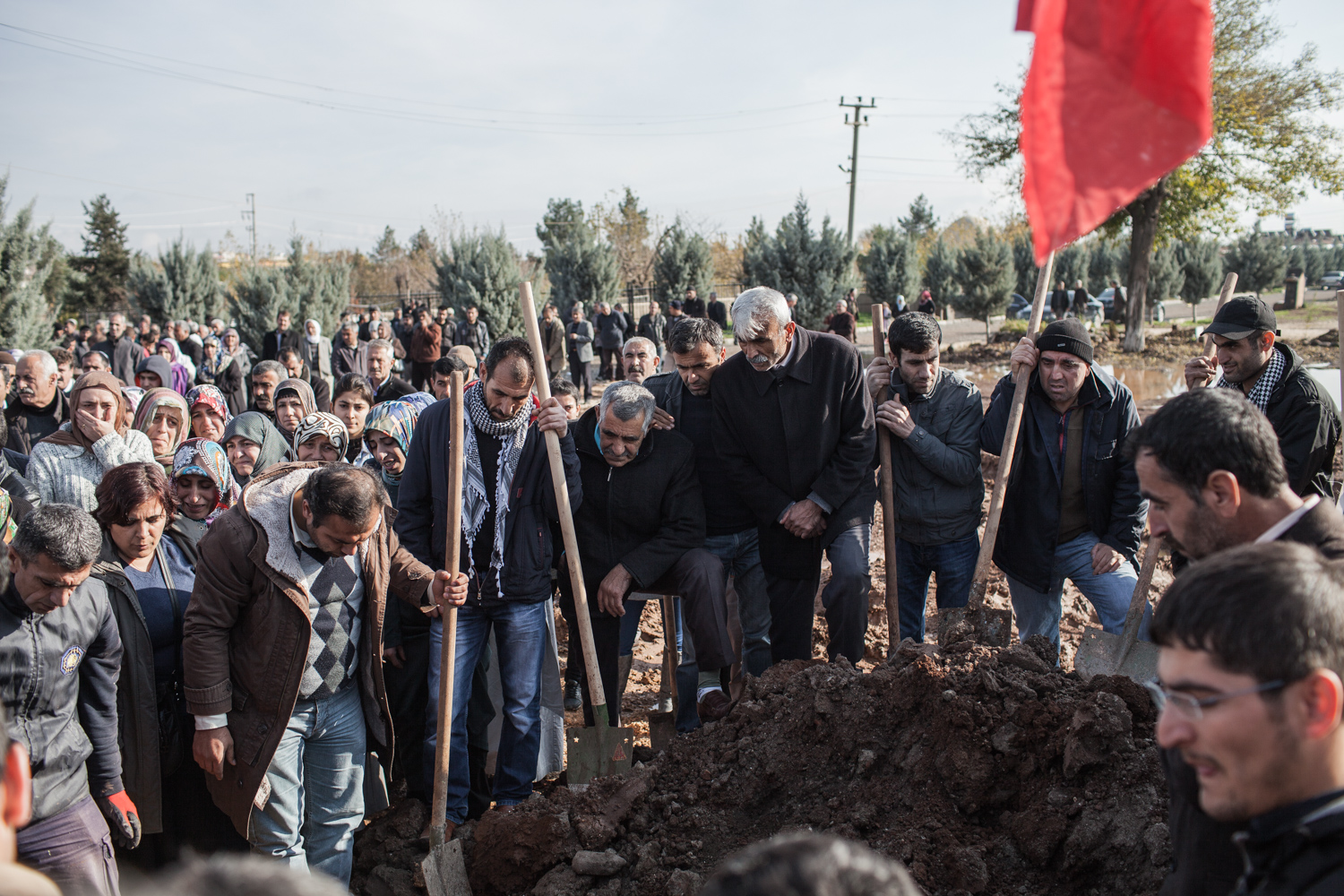 Burial of a female PKK fighter in Diyarbakir in Turkey. While men are seen digging the crave, women are crying in the background
