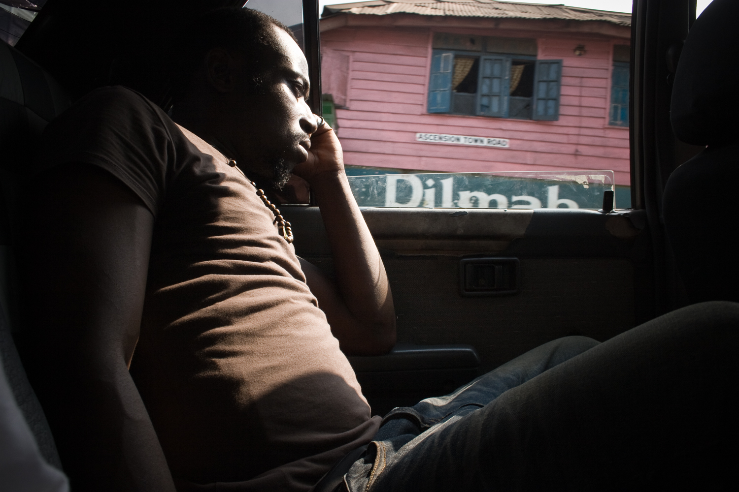 Former child soldier Francis is sitting in a taxi in Sierra Leone's capital Freetown and is looking out the window. Francis fought as a child soldier in the country's civil war from 1991 until 2002
