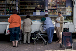 Women are buying groceries at a mobile market in Frankfurt's district Praunheim