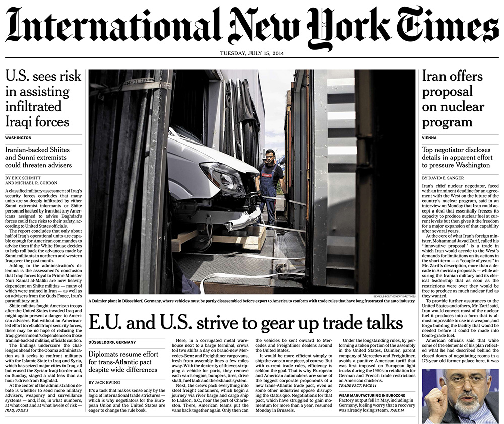 tearsheet of the frontpage of The International New York Times. On the photo a worker can be seen at the harbour in Dusseldorf moving a Mercedes Benz van into a container that will be shipped to the United States.