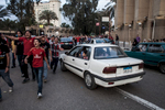 Members of the Ultras Ahlawy protesting next to the Ahly club centre in Zamalek/Cairo in April 2012. Young men are seen chanting while passersby watch