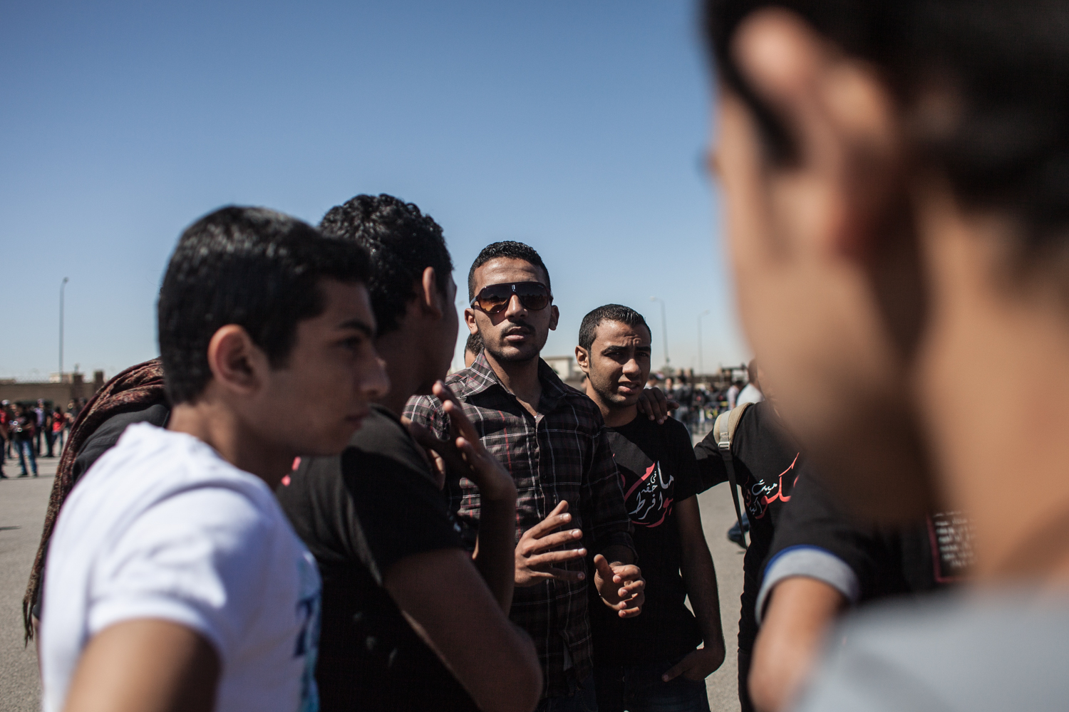 Ahlawy Sherif talking to other Ultras during a protest of the Ultras in front of the Police Academy in New Cairo where the Port Said trial is held