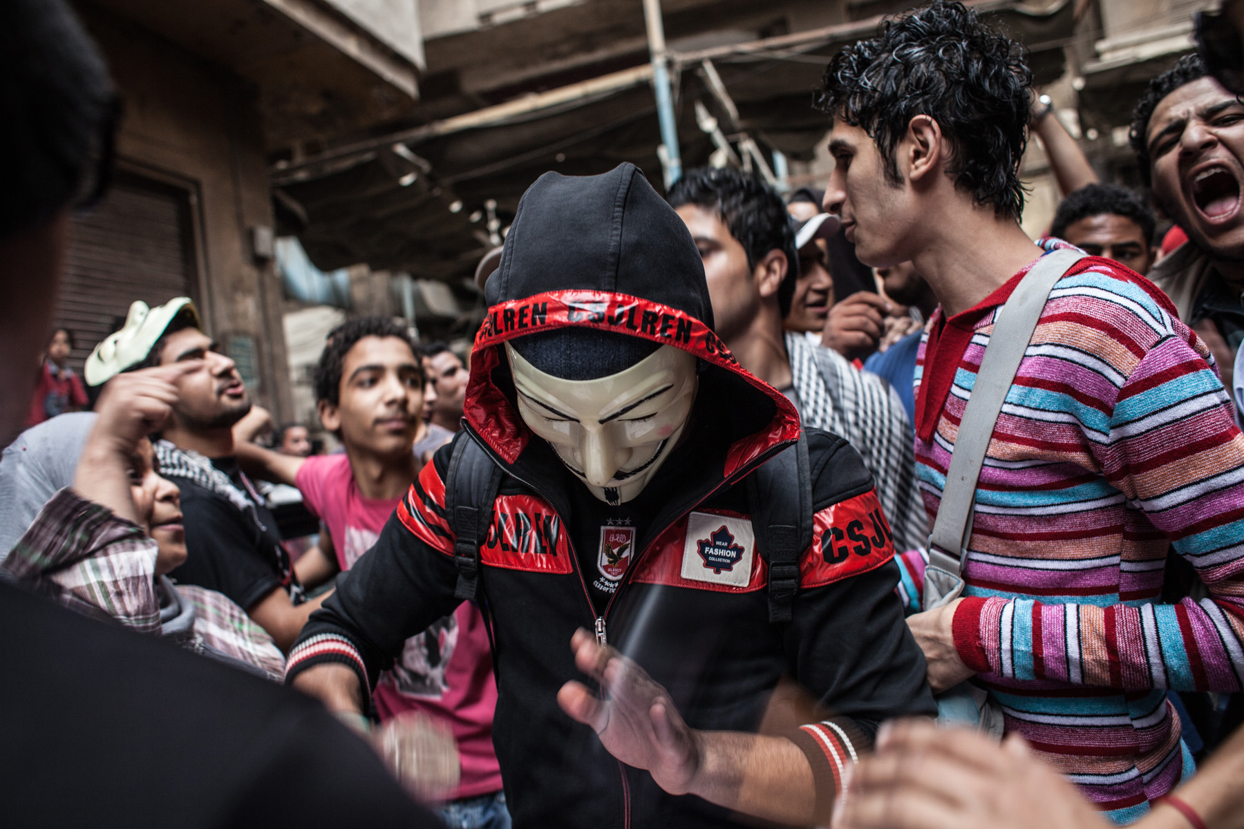 Ahlawy protesting in Mohamed Mahmoud Street in Cairo. One member is masked and is seen drumming