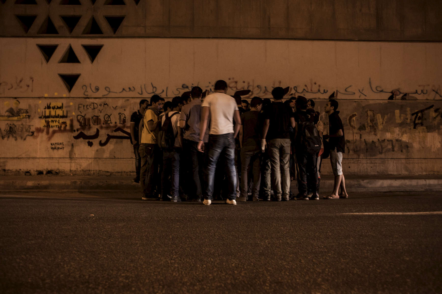 Ultras holding a secret meeting next to the International Stadium in Cairo. The Ultras favorite football club, Al Ahly, was usually playing its matches inside the stadium. But because of the stadium massacre in Port Said professional football matches where suspende in Egypt for months