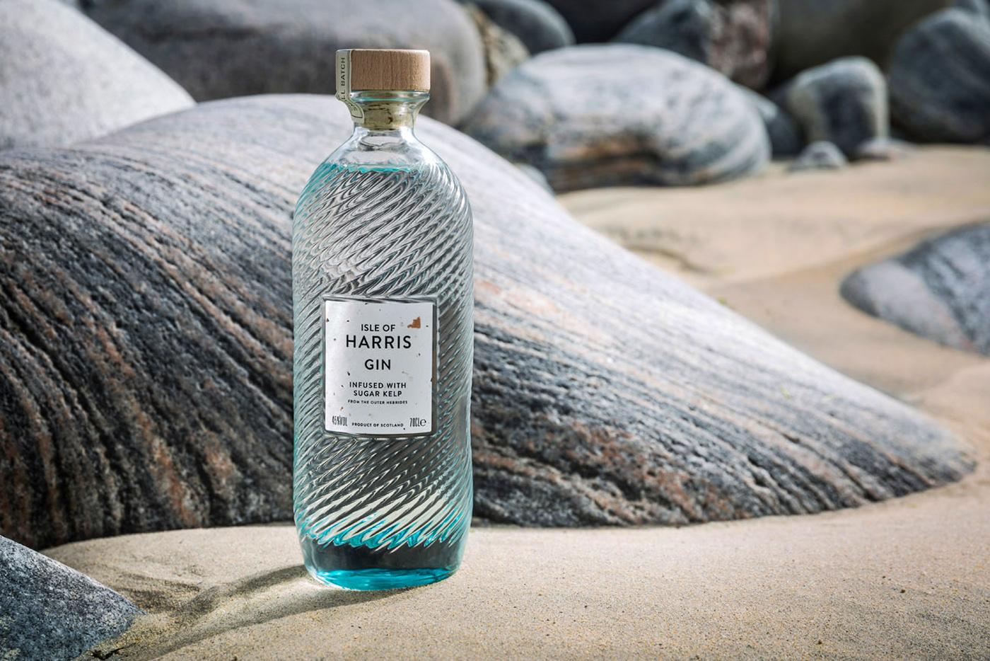 Harris Distillery gin bottle on the beach