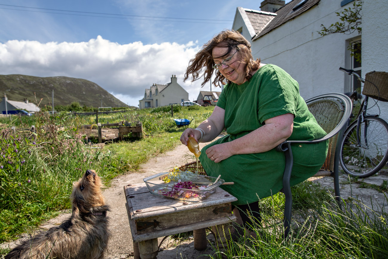 Amand Saurin, an apothecarist making rosewater in her garden in Northton, Isle of harris.