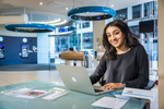 Environmental portrait of young woman at work in a bank.