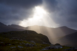 shaft of light in the mountains. Moody shot of angel rays on a stormy day.