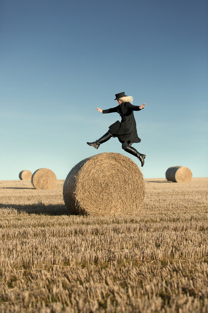 Hazel leaps over a hay bale