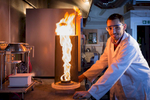 Student studying at Edinburgh University with a firenado in a lab