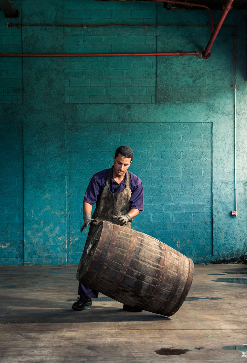 Havana Club cooper moving a barrel of Rum