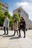 Students studying at Edinburgh University in Bristo Square.