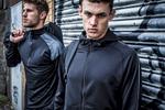 model wearing Tombo sportswear at SWG3 in Glasgow against shutters