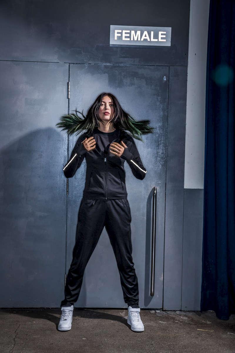 Amanda Hendricks model wearing Tombo sportswear at SWG3 in Glasgow by metal doors