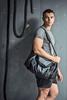 model wearing Tombo sportswear in a grungy gym