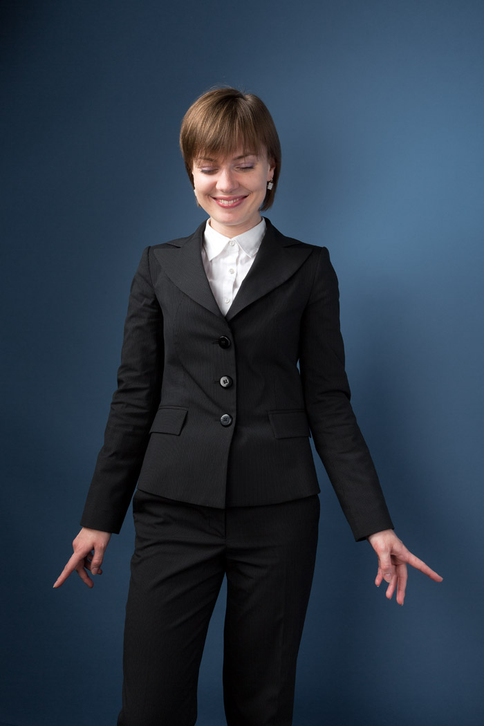 quirky portrait of business woman in a studio