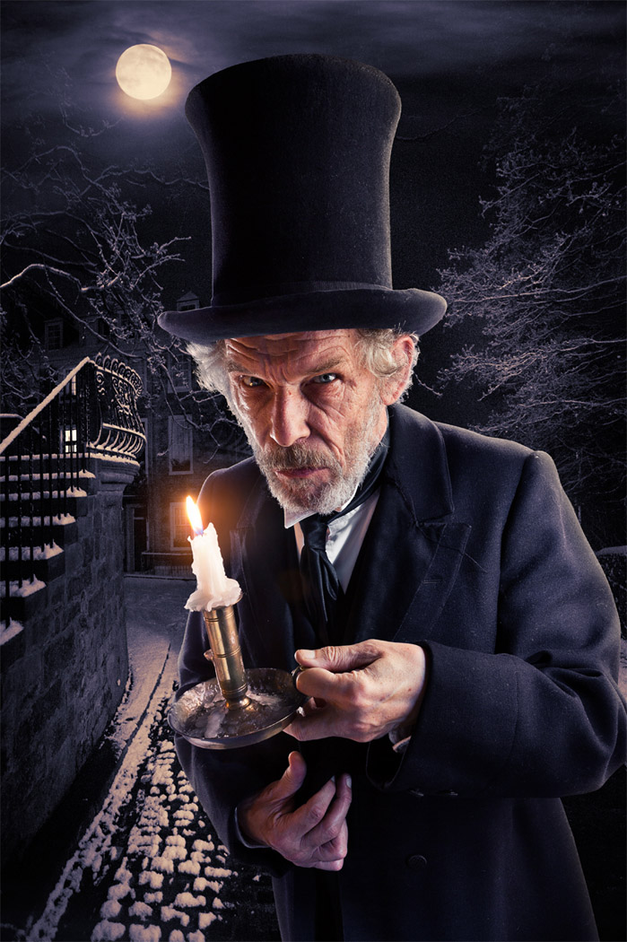portrait of  Christopher Fairbank as Scrooge outside at night for A Christmas Carol at the Lyceum Theatre