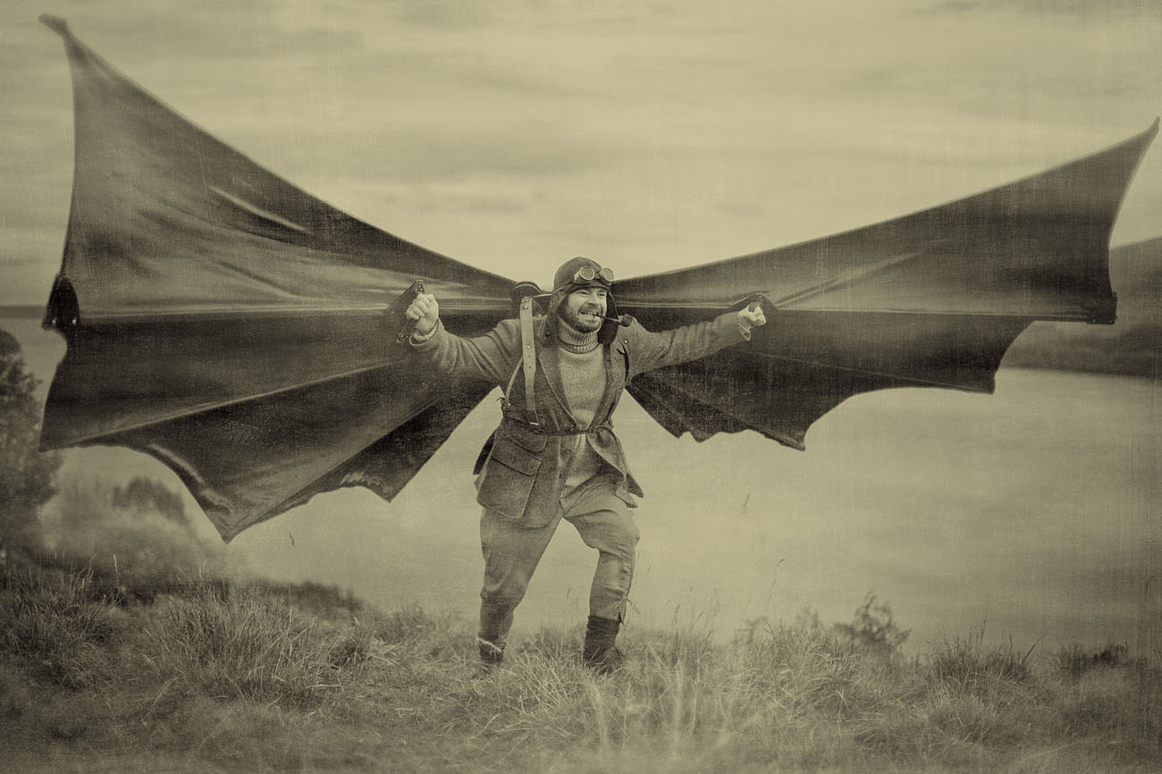 Otto, a man with home made wings runs to take off with wings spread