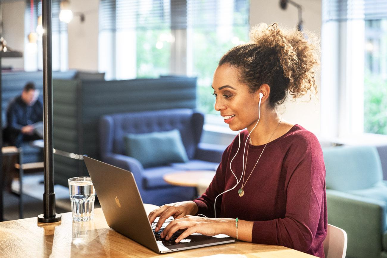 black woman-workingat a laptop in a luxury hotel