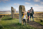 Historic Scotland  - family walking around the ring of Brodgar on Orkney
